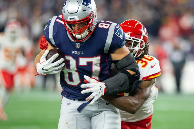 New England Patriots tight end Rob Gronkowski (87) is tackled by Kansas City Chiefs safety Josh Shaw (30) after a 39-yard reception during their game at Gillette Stadium in Foxborough, Massachusetts on October 14, 2018. Photo by Matthew Healey/UPI