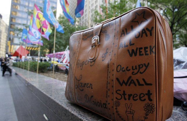 A Suitcase with Occupy Wall Street messages sits around the perimeter of Zuccotti Park on the 30 day anniversary of the Occupy Wall Street Protest Movement In New York City on October 17, 2011. UPI/John Angelillo