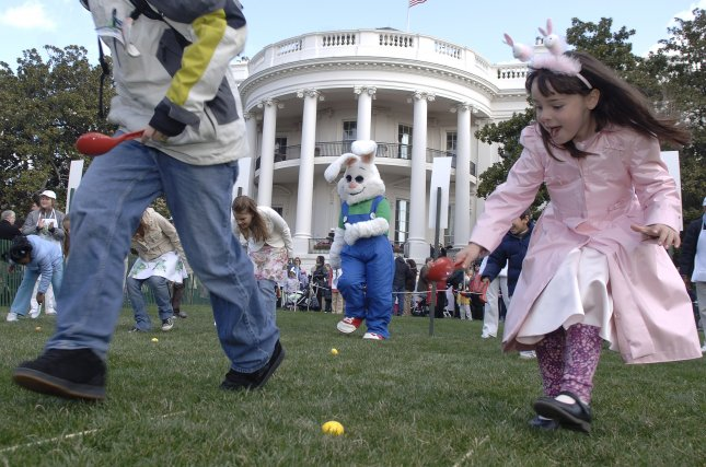 Children roll Easter eggs during the annual White House Easter Egg Roll on the South Lawn of The White House, in Washington on April 9, 2007. The White House Easter Egg Roll has been an annual tradition since 1878, when it was started by President Rutherford B. Hayes. (UPI Photo/Kevin Dietsch)