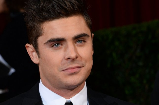 Actor Zac Efron arrives on the red carpet at the 86th Academy Awards at the Hollywood and Highland Center in the Hollywood section of Los Angeles on March 2, 2014. UPI/Jim Ruymen