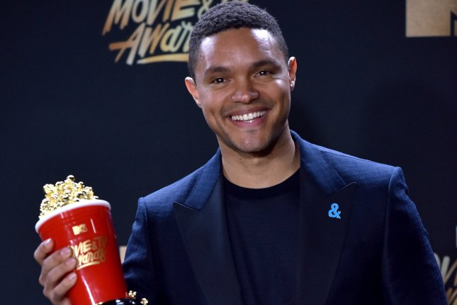 Trevor Noah appears backstage with the Best Host award for The Daily Show during the MTV Movie & TV Awards on May 7. Comedy Central has decided to keep Noah the host of The Daily Show through 2022. File Photo by Christine Chew/UPI