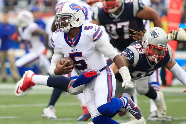 Buffalo Bills quarterback Tyrod Taylor (5) dodges a tackle by New England Patriots defensive lineman Jabaal Sheard (93) on a four-yard keeper in the third quarter at Gillette Stadium in Foxborough, Massachusetts on October 2, 2016. File photo by Matthew Healey/UPI