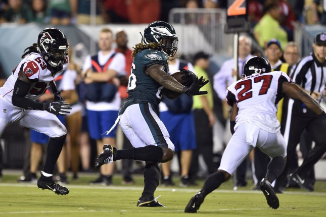 Philadelphia Eagles running back Jay Ajayi (26) runs the ball for a touchdown past Atlanta Falcons safety Damontae Kazee (27) during the second half on September 7, 2018 at Lincoln Financial Field in Philadelphia. Photo by Derik Hamilton/UPI