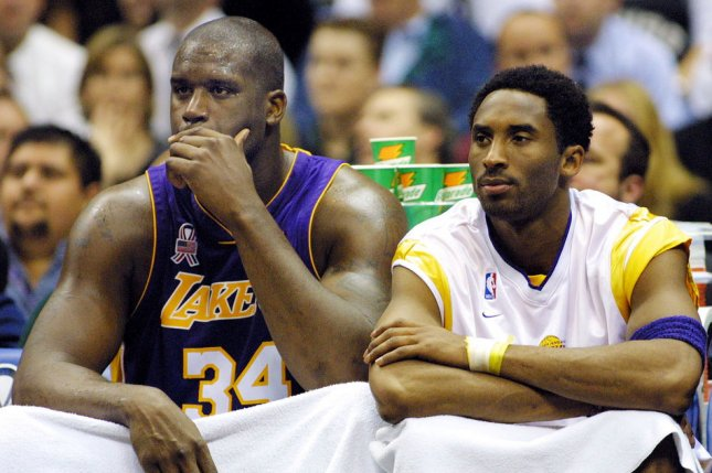 Former Los Angeles Lakers teammates Shaquille O'Neal (L) and Kobe Bryant watch from the bench during the fourth quarter of a game on March 21, 2002, in San Antonio. File Photo by Joe Mitchell/UPI