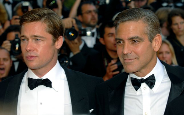 George Clooney (R) and Brad Pitt arrive at the Palais des Festivals for the gala screening of Ocean's Thirteen at the 60th Cannes Film Festival in Cannes, France on May 24, 2007. (UPI Photo/Christine Chew)