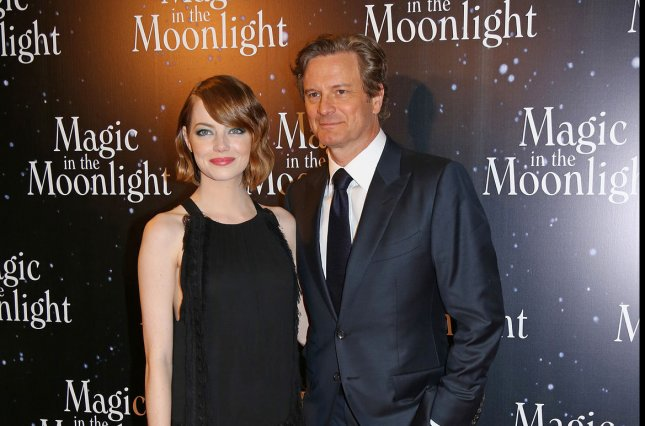 Emma Stone (L) and Colin Firth arrive at the French premiere of the film Magic in the Moonlight in Paris on September 11, 2014. UPI/David Silpa.