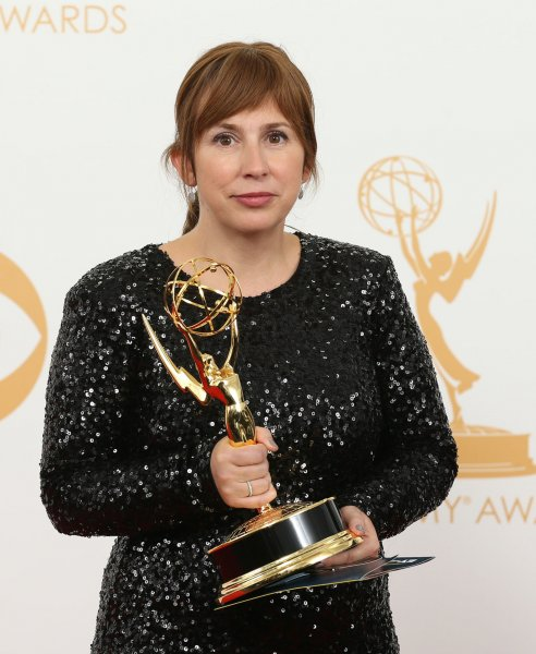 Writer Abi Morgan holds the statuette she won at the 65th Primetime Emmy Awards in Los Angeles on September 22, 2013. Morgan has written a new, six-part drama called The Split for Sundance and the BBC. File Photo by Danny Moloshok/UPI