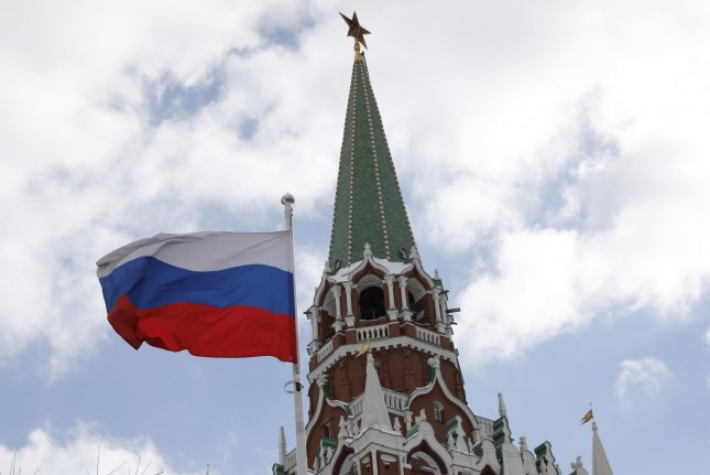 A Russian flag flies near the Kremlin tower in Moscow on March 16. Photo by Yuri Gripas/UPI