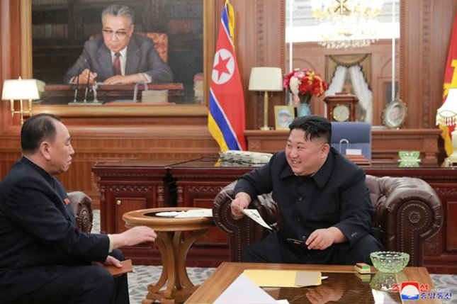 North Korean leader Kim Jong Un (R) continues to be idolized in the country, according to a recent press report. File Photo by KCNA/UPI
