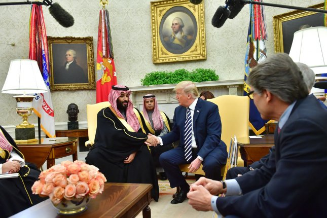 President Donald Trump (R) shakes hands with Saudi Crown Prince Mohammed bin Salman of the Kingdom of Saudi Arabia on March 20, 2018. On Friday, Trump approved $8 billion in arms sales, some of which will go to Saudi Arabia. File Photo by Kevin Dietsch/UPI