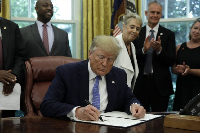 U.S. President Donald Trump signed an Executive Order Establishing a White House Council on Eliminating Regulatory Barriers to Affordable Housing in the Oval Office at the White House in Washington, DC. on Tuesday. Photo by Yuri Gripas/UPI