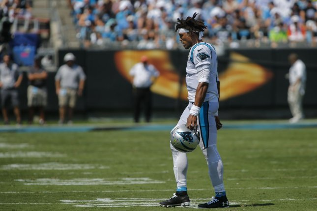 new styles 89084 09394 Panthers QB Cam Newton 'low' after re-aggravating foot ...