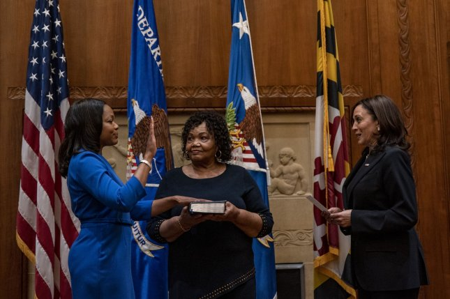 Kristen Clarke holds her hand up and her mom, Pansy Clarke, holds a Bible a as Vice President Kamala Harris swears her in at the Department of Justice in Washington, D.C., on Tuesday. Photo by Tasos Katopodis/UPI