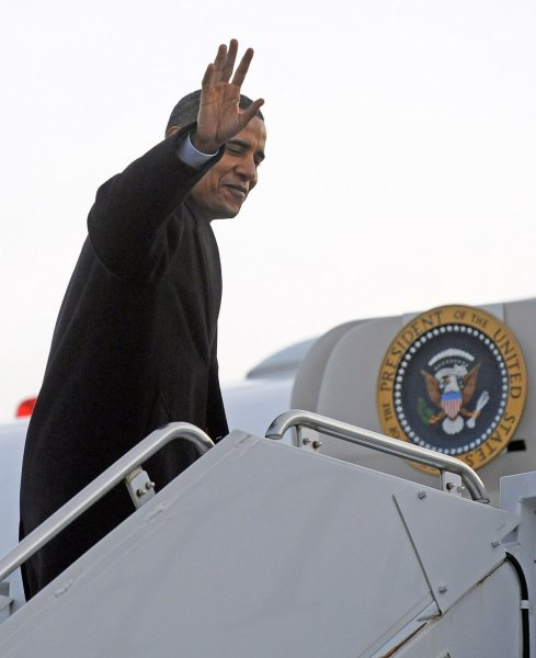 U.S. President-elect Barack Obama climbs the stairs to board the airplane that will take him to Washington, D.C. at Midway Airport in Chicago, Illinois on January 4, 2009. Obama will join his wife and children who are already in Washington as he prepares for his January 20, 2009 inauguration. (UPI Photo/Tannen Maury/Pool)