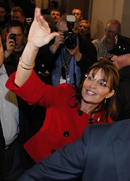 Former Alaska Gov. Sarah Palin waves to supporters as she arrives at a signing of her new book Going Rogue: An American Life at the Woodland Mall Barnes & Noble in Grand Rapids, Michigan on November 18, 2009. Palin is continuing the book signing tour in the coming weeks with stops at select Barnes & Noble stores in Virginia, Iowa, Minnesota, South Dakota and Florida. UPI/Brian Kersey