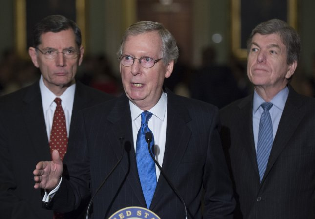 Senate Minority Leader Mitch McConnell (R-KY) speaks to reporters on the extension of unemployment insurance on Capitol Hill in Washington, D.C., January 7, 2014. McConnell was joined by Sen. John Barrasso (R-WY) (L) and Sen. Roy Blunt (R-MO). UPI/Kevin Dietsch