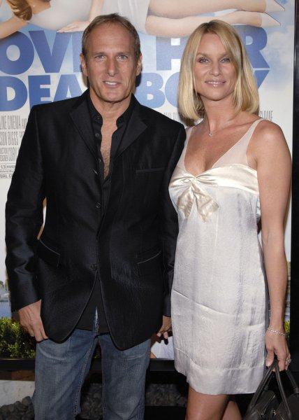 Singer Michael Bolten (L) and actress Nicolette Sheridan attend the premiere of Over Her Dead Body in Los Angeles on January 29, 2008. (UPI Photo/ Phil McCarten)