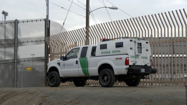A Border Patrol vehicle is parked looking south into Tijuana, Mexico from the secondary fence in San Diego. The U.S. Senate passed a comprehensive immigration bill today that would put an estimated 8 million illegal immigrants on a path to citizenship and spend $46 billion to tighten the nation's borders. (UPI Photo/Earl Cryer).