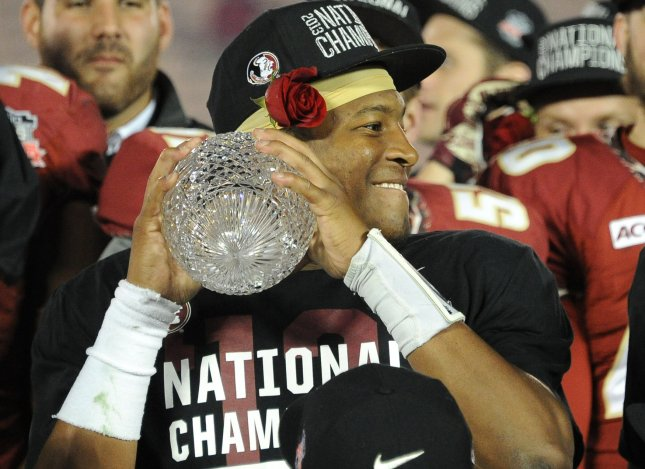 Florida State Seminoles quaterback Jameis Winston prepares to throw the National Championship trophy after victory over the Auburn Tiger's during the BCS national title game at the Rose Bowl in Pasadena, California on January 6, 2014. Florida State defeated Auburn by a score of 34-31. UPI/Jon SooHoo