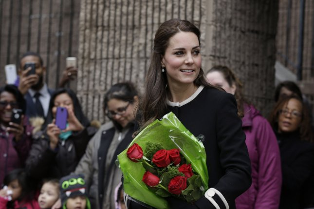 Duchess of Cambridge Kate Middleton receives flowers after visiting the Northside Center for Childhood Development in New York, Monday, December 8, 2014. The Duke and Duchess of Cambridge are on a three-day visit to the United States. UPI/Seth Wenig/Pool
