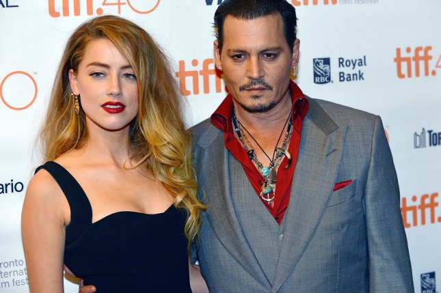 Johnny Depp and Amber Heard arrive at the Toronto International Film Festival premiere of 'Black Mass' at the Elgin Theatre in Canada on Sept. 14, 2015. Photo by Christine Chew/UPI