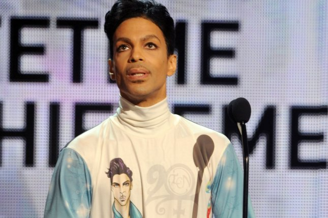 Prince accepting BET's Lifetime Achievement Award in 2010. The musician has announced a new piano and microphone only tour. File Photo by Jim Ruymen/UPI
