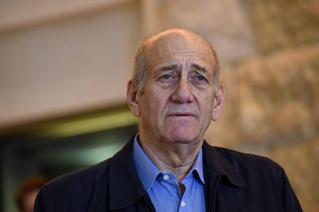 Former Israeli Prime Minister Ehud Olmert speaks to the press in the Supreme Court on Tuesday after the court reduced his sentence from six years to 18 months in prison for taking bribes in the Holyland corruption case in Jerusalem, Israel. Olmert's sentence is scheduled to begin February 15. Photo by Debbie Hill/ UPI
