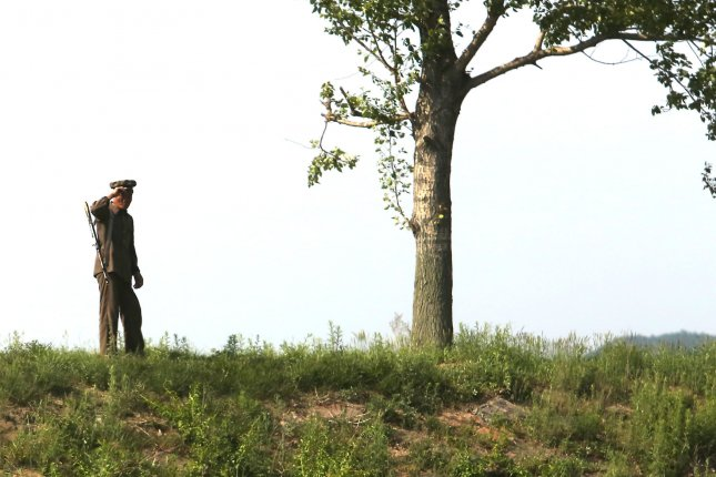 A North Korean solider patrols the border near the North Korean city Sinuiju, across the Yalu River from Dandong, China's largest border city with North Korea. Pyongyang has signaled it has no intention of giving up nuclear weapons but it is still seeking dialogue with the United States, a South Korean analyst said. File Photo by Stephen Shaver/UPI