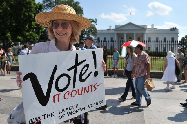 A member of the League of Women Voters participates in a demonstration to protest the lack of voting rights for the citizens of Washington, D.C., on the 90th Anniversary of the 19th Amendment, guaranteeing women the right to vote in 2010. The LWV is suing a federal official over a change to the federal voter registration form, requiring individuals in three states provide proof of citizenship in order to be registered. File photo by Kevin Dietsch/UPI