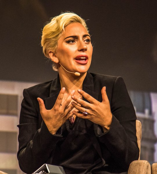 The Dalai Lama (Not shown) and Lady Gaga discuss issues at a forum during the 84th Annual Meeting of the United States Conference of Mayors on June 26, 2016. She will perform at the concert Camden Rising as part of the Democratic National Convention. Photo by Edwin Locke/UPI