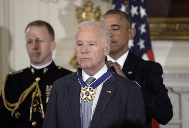 President Barack Obama presents the Medal of Freedom to Vice President Biden during an event in the State Dining Room of the White House in Washington, D.C., on January 12. Pool Photo by Olivier Douliery/UPI