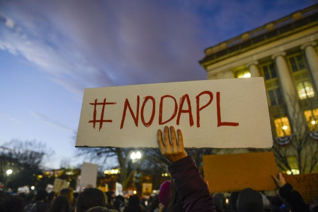 A tribe at the center of the fight over the Dakota Access oil pipeline vows legal action after Trump administration maneuvers over final construction hurdle. Photo by Leigh Vogel/UPI