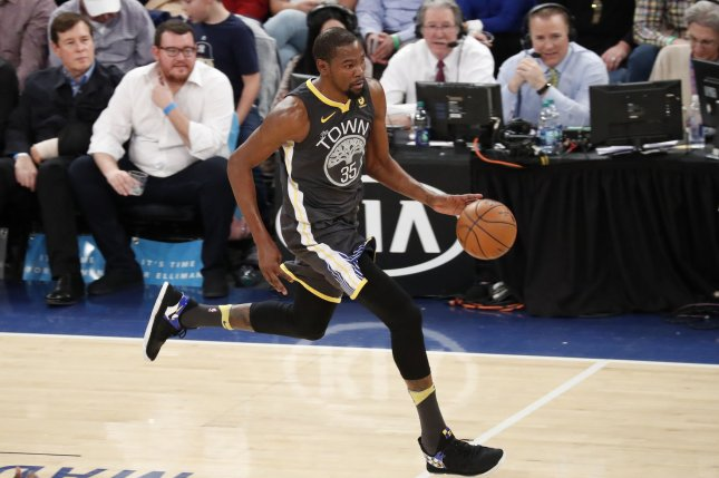 Golden State Warriors forward Kevin Durant dribbles the basketball up the court in the third quarter against the New York Knicks on February 26, 2018 at Madison Square Garden in New York City. Photo by John Angelillo/UPI