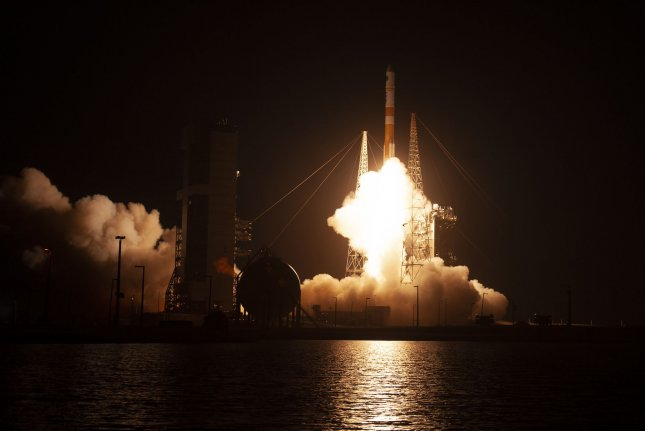 A United Launch Alliance Delta IV rocket lifts off at 8:26 PM from Launch Complex 37 at the Cape Canaveral Air Force Station, Fla. on Friday. Photo by Joe Marino-Bill Cantrell/UPI