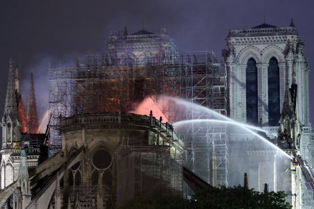 Firefighters battle to extinguish a giant fire that engulfed the Notre Dame Cathedral. Photo by Eco Clement/UPI