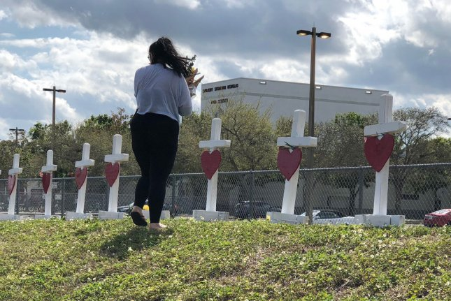Flowers and Seventeen crosses honor the victims of the shooting attack at Marjory Stoneman Douglas High School on February 18, 2018, in Parkland, Fla. File Photo by Gary Rothstein/UPI