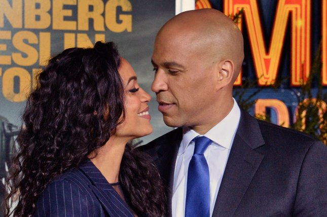 Rosario Dawson (L), pictured with Cory Booker, discussed her experience playing Ahsoka Tano on the Star Wars series The Mandalorian. File Photo by Jim Ruymen/UPI