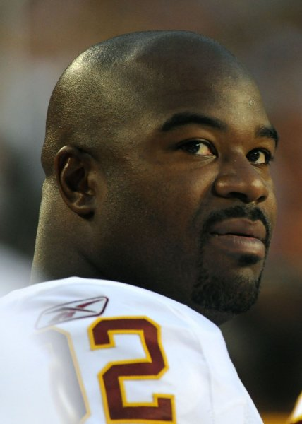 Washington Redskins' Albert Haynesworth is seen on the sidelines as the Redskins play a pre-season game against the Buffalo Bills at FedEx Field in Washington on August 13, 2010. UPI/Kevin Dietsch