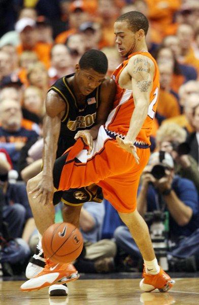 Missouri Tigers Stefhon Hannah (L) gets a knee block from Illinois Fighting Illini's Chester Frazier in the first half of the annual Braggin' Rights game at the Scottrade Center in St. Louis on December 19, 2006. (UPI Photo/Bill Greenblatt)