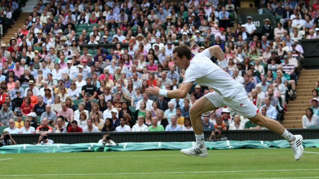 Britain's Andy Murray runs for the ball in his match against Nikolay Davydenko on the second day of the 2012 Wimbledon championships in London, June 26, 2012. UPI/Hugo Philpott