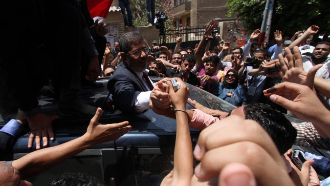Presidential candidate of the Muslim Brotherhood, Mohamed Morsy, waves after casting his vote at a polling station in a school in Al-Sharqya, 60 km (37 miles) northeast of Cairo in Egypt, June 16, 2012. Egypt's first free presidential election concludes this weekend in a run-off between the Muslim Brotherhood's candidate Mohamed Morsy and Ahmed Shafik, the last prime minister of ousted leader Hosni Mubarak. UPI/Ahmed Jomaa