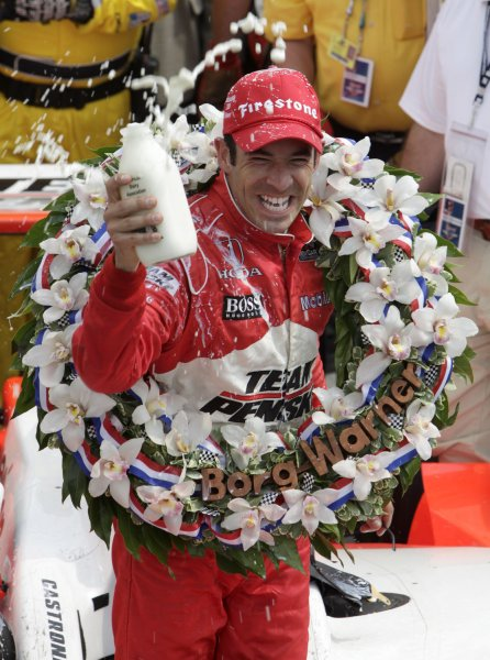 Helio Castroneves of Brazil, celebrates with the tradition bottle of milk after winning the 93nd Indy 500 at the Indianapolis Motor Speedway May 24, 2009. (UPI Photo/Mark Cowan)