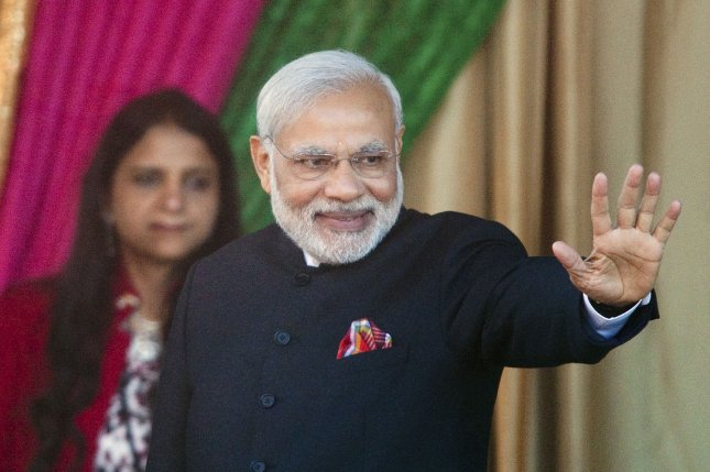 India's Prime Minister Narendra Modi waves to the crowd at the Laxmi Narayan Hindu Temple in Surrey near Vancouver, British Columbia, April 16, 2015. On August 16, 2015, Modi became the fist Indian prime minister in 34 years to visit the United Arab Emirates. Modi is visiting to the Emirates to discuss the strategic partnership shared by the two nations. File photo by Heinz Ruckemann/UPI