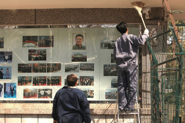 Chinese maintenance workers clean the North Korean embassy's display case in Beijing, China. Kim Jong Il's former bodyguard said current leader Kim Jong Un is neglecting the welfare of ordinary North Koreans while building luxury villas across the country. Photo by Stephen Shaver/UPI