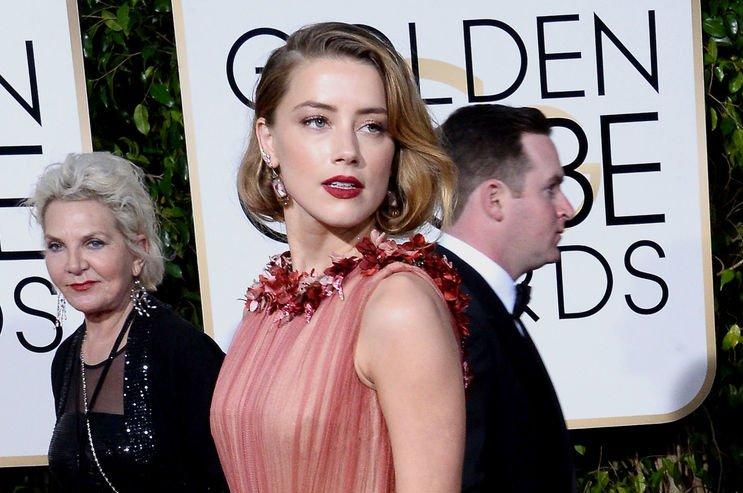 Amber Heard attends the Golden Globe Awards on January 10, 2016. File Photo by Jim Ruymen/UPI