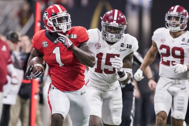 Georgia Bulldogs running back Sony Michel (1) looks back at Alabama Crimson Tide defensive back Ronnie Harrison (15) and Alabama Crimson Tide defensive back Minkah Fitzpatrick (29) on a long run in the first quarter of the NCAA College Football Playoff National Championship on January 8 at Mercedes-Benz Stadium in Atlanta. Photo by Mark Wallheiser/UPI