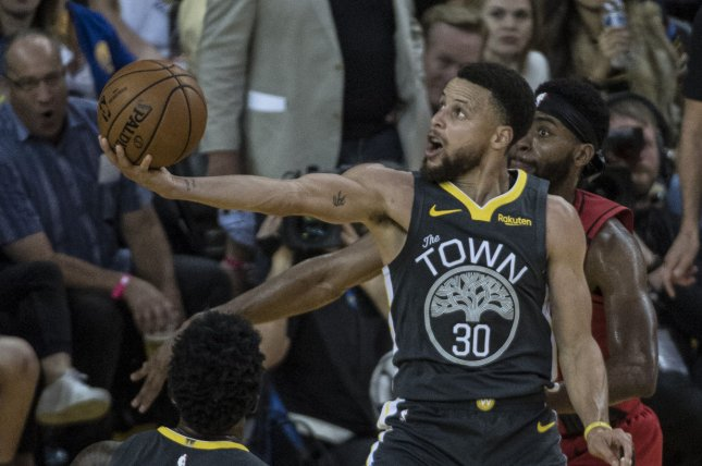Golden State Warriors guard Stephen Curry suffered a broken hand during Wednesday's loss to the Phoenix Suns. File Photo by Terry Schmitt/UPI