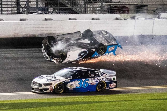 David Ragan (36) maneuvers by the inverted car of Ryan Newman at the finish of the 62nd Daytona 500 on Monday in Daytona Beach, Fla. Photo by Edwin Locke/UPI