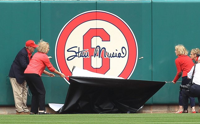 The children of the late Stan Musial pull the cover off of the No. 6 on the left center field wall at Busch Stadium in St. Louis, April 8, 2013. UPI/Bill Greenblatt