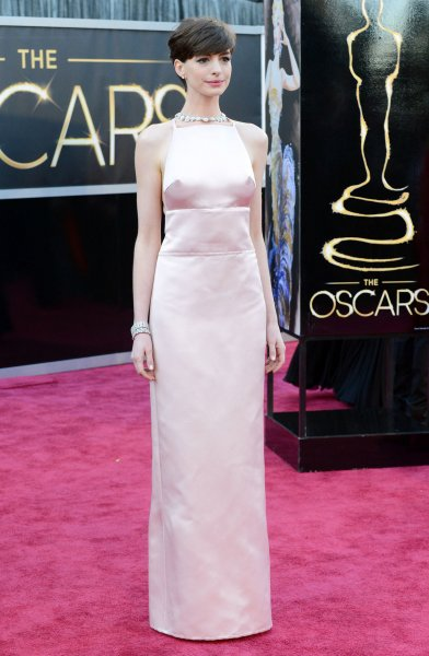 Anne Hathaway arrives on the red carpet at the 85th Academy Awards at the Hollywood and Highlands Center in the Hollywood section of Los Angeles on February 24, 2013. UPI/Kevin Dietsch